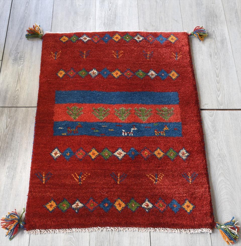 ギャッベ/GABBEH ベーシックな織り カシュカイ族の手織り・玄関マットサイズ85×60cmレッド 幾何学模様 動物と植物のモチーフ