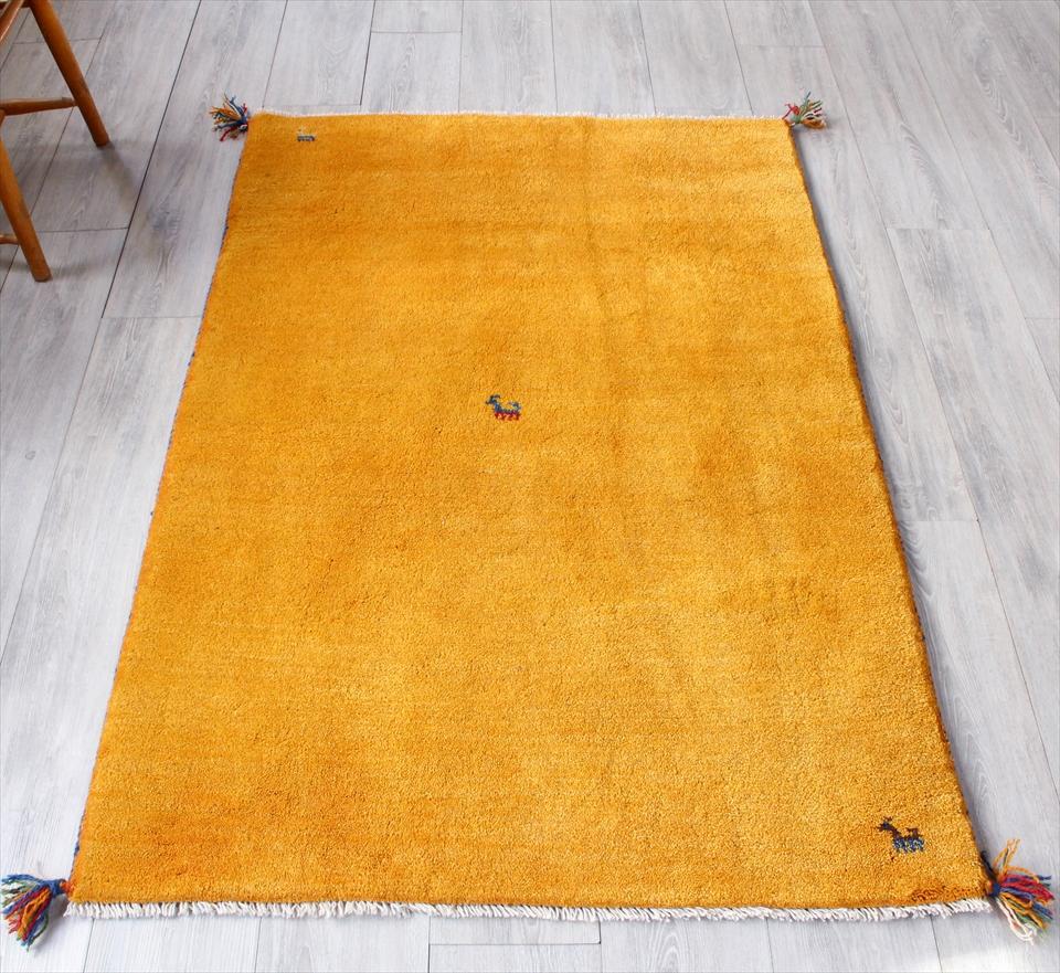 ギャッベ・カシュカイ族の手織りラグ・アクセントラグサイズ150x103cm イエロー 動物のモチーフ