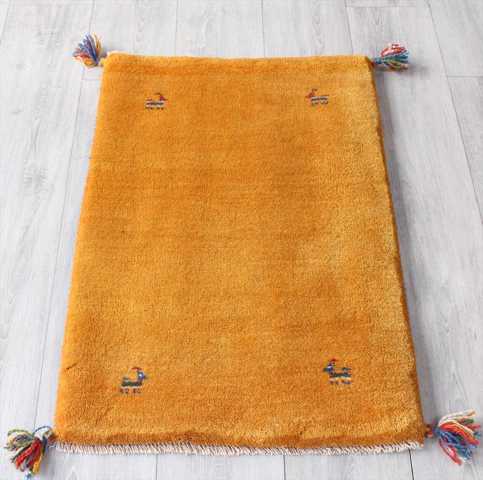 ギャッベ・カシュカイ族の手織りラグ・玄関マットサイズ83x56cm イエロー 動物のモチーフ