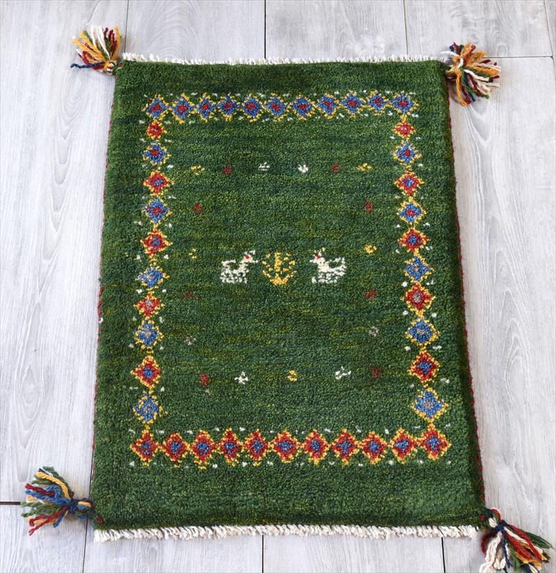 イラン手織りギャッベ・玄関マット ミニサイズ58x42cm グリーン・カラフルダイヤボーダー 動物と植物のモチーフ