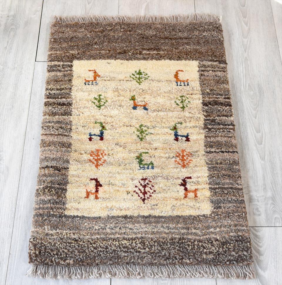 ギャッベ・ノマド Nomad カシュカイ族の手織りラグ・ミニサイズ60×40cmナチュラルアイボリ/グレーグラデーション・動物と植物のモチーフ