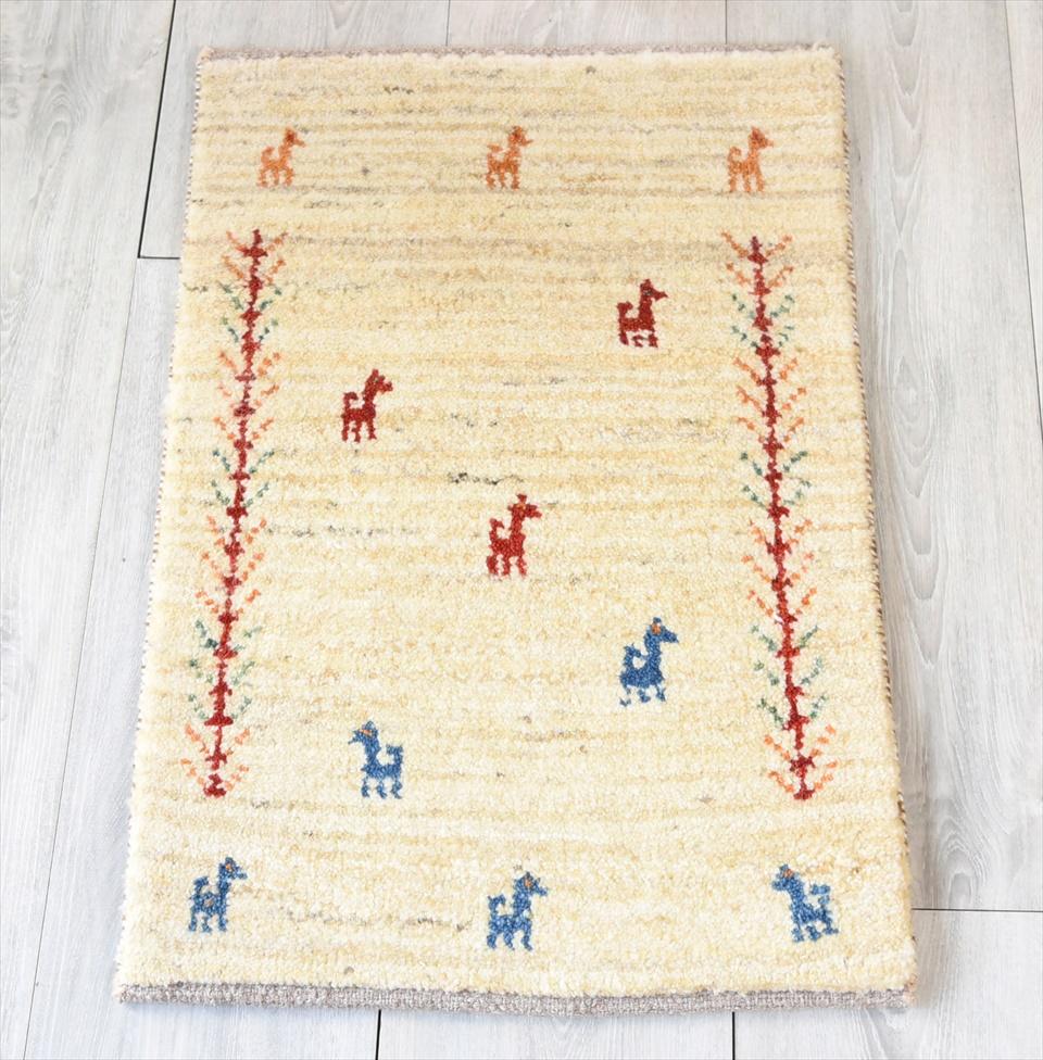 ギャッベ・ノマド Nomad カシュカイ族の手織りラグ・ミニサイズ60×40cmナチュラルアイボリー・動物と植物のモチーフ