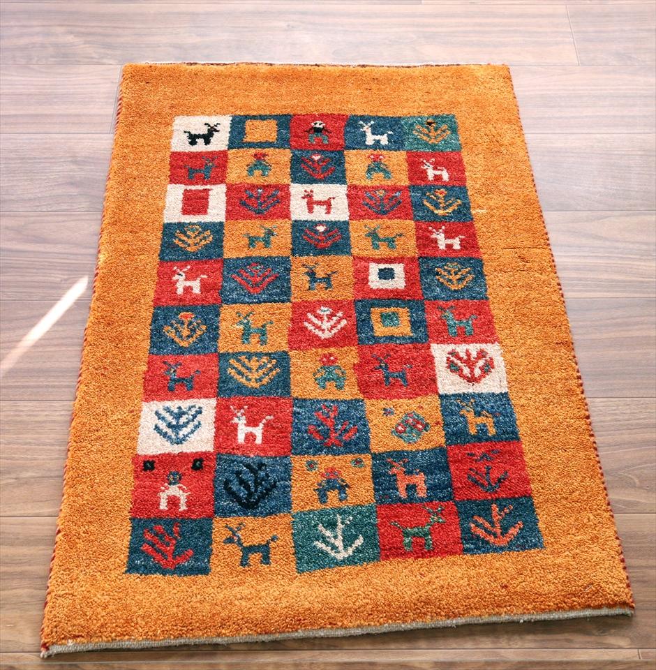 ギャッベ・ノマド Nomad イラン手織り 玄関サイズ90×60cmオレンジ/カラフルタイル・動物と植物のモチーフ