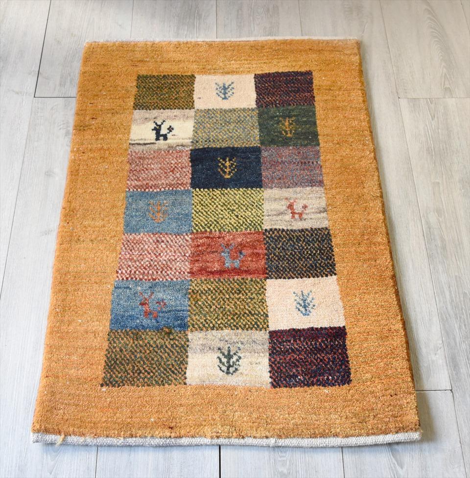 ギャッベ・ノマド Nomad イラン手織り 玄関サイズ85×58cmカラフルタイル/イエロー・動物と植物のモチーフ