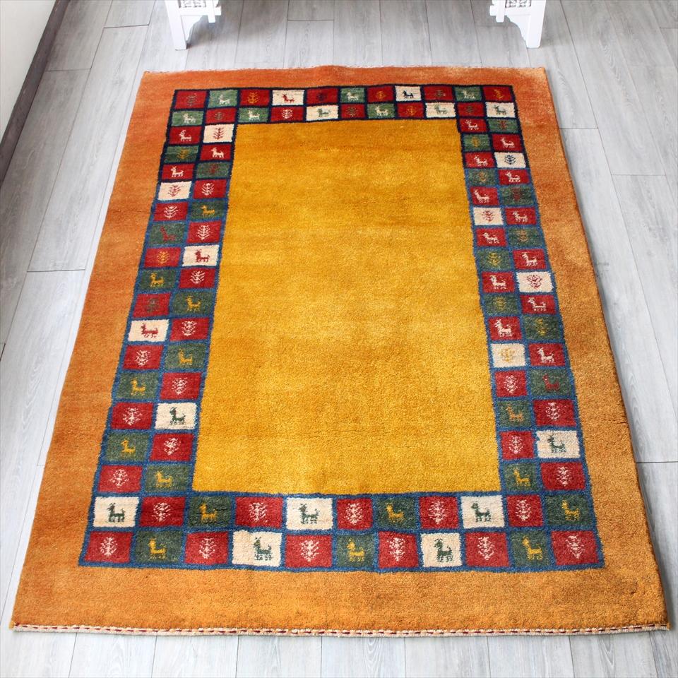 ギャッベ・ノマド/スタンダードな織り センターラグサイズ194x150cm イエロー&オレンジ カラフルタイルボーダー 動物と植物モチーフ