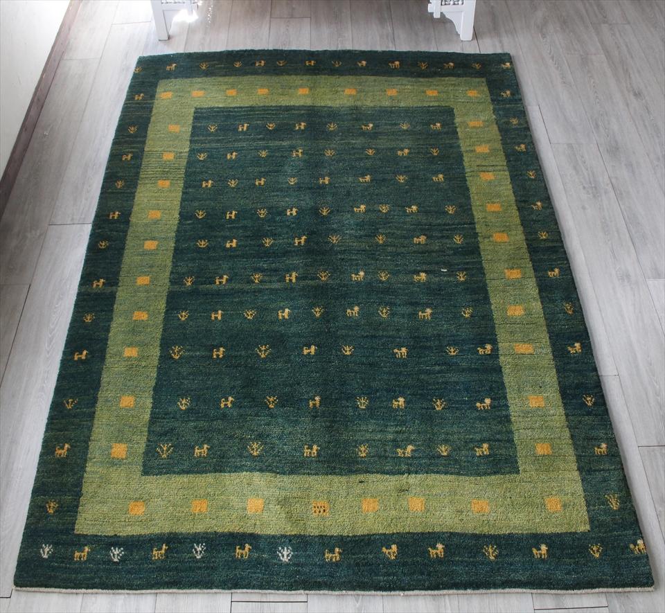 ギャッベ・ノマド/スタンダードな織り リビングサイズ212x160cm グリーン・ボーダー(額縁) 動物と植物モチーフ