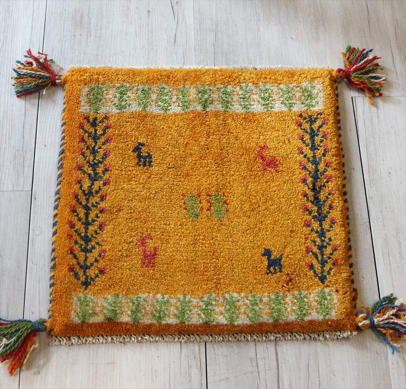 ギャッベ Gabbeh イラン南部の遊牧民・カシュカイ族の手織りラグ40x38cm 座布団サイズ マスタードイエロー 動物と植物