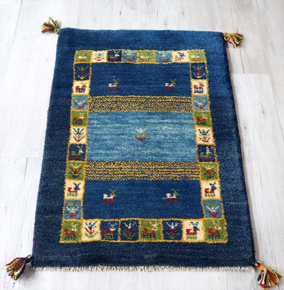 ギャベ カシュカイ族の手織り 玄関マットサイズ 87x60cm ブルー カラフルタイルボーダー 動物と植物モチーフ