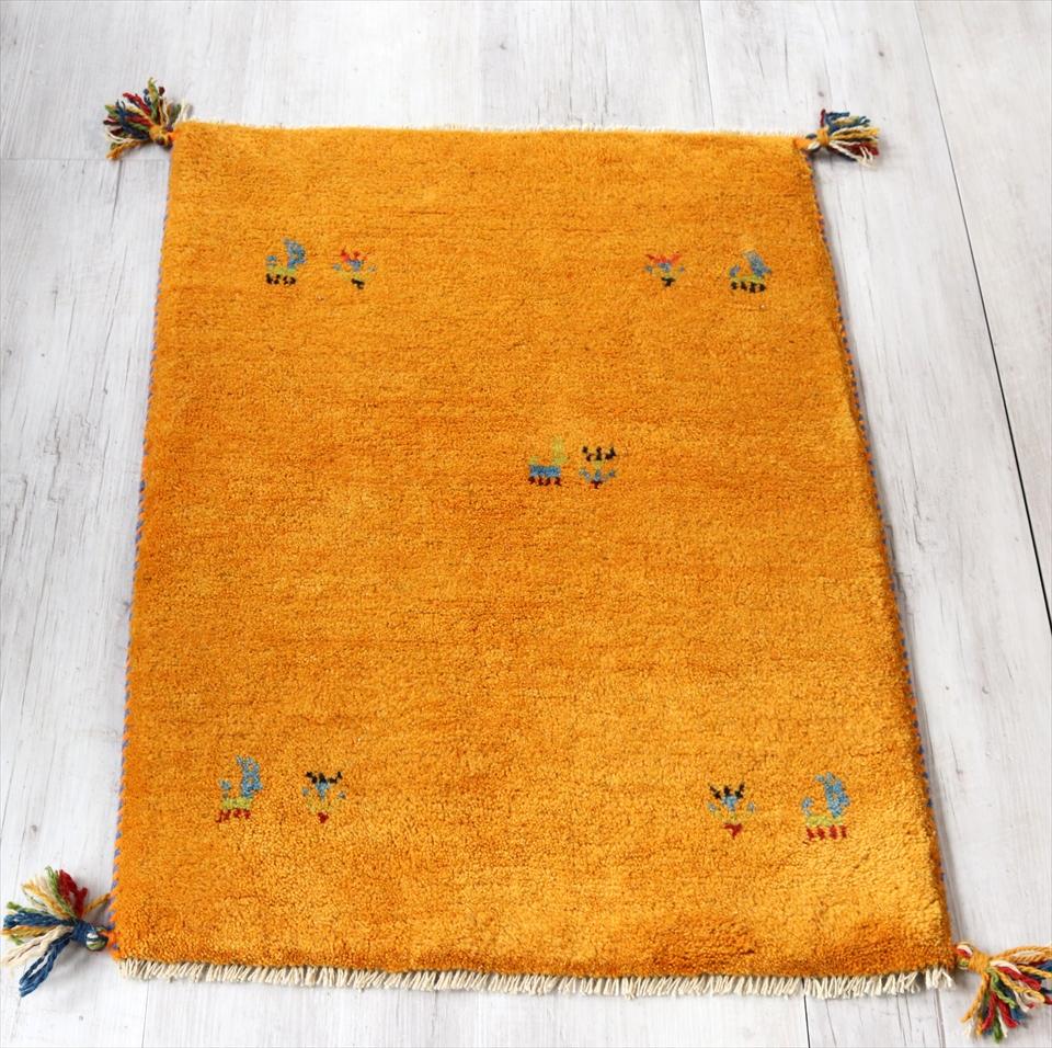 ギャッベ 厚手 カシュカイ族の手織り 玄関マットサイズ 83x60cm オレンジ・動物と植物モチーフ