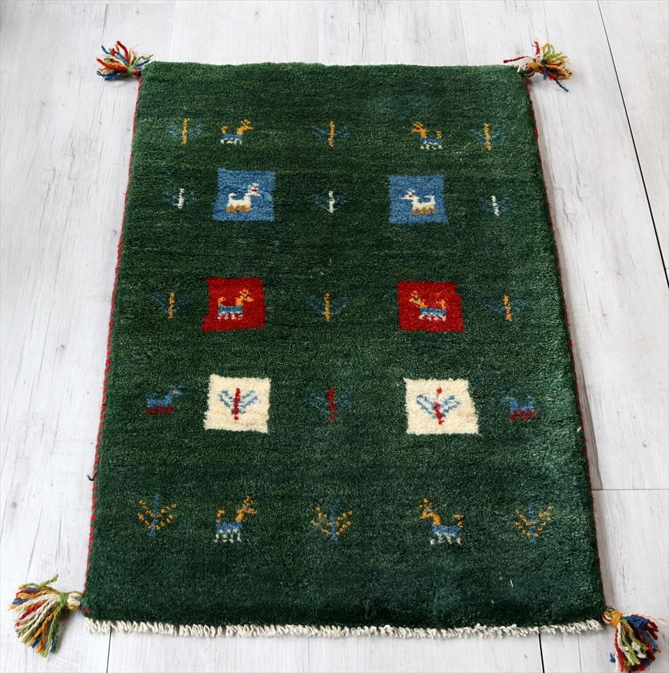 ギャベ イラン製 カシュカイ族の手織りラグ 玄関マットサイズ 88x56cm ダークグリーン カラフルなスクエア 動物と植物モチーフ