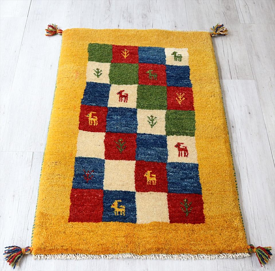 ギャベ カシュカイ族の手織り 玄関マットサイズ 96x62cm イエロー カラフルタイル 動物と植物モチーフ