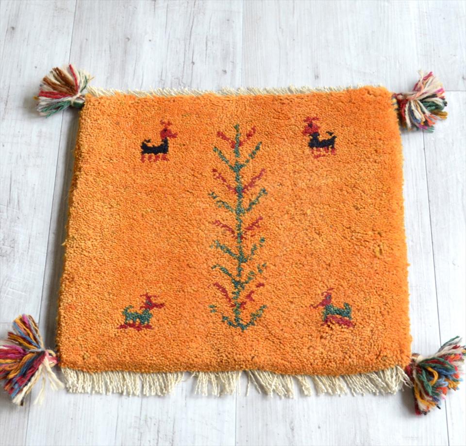 ギャッベ Gabbeh イラン南部の遊牧民・カシュカイ族の手織りラグ39x41cm 座布団サイズ オレンジ 動物と植物モチーフ