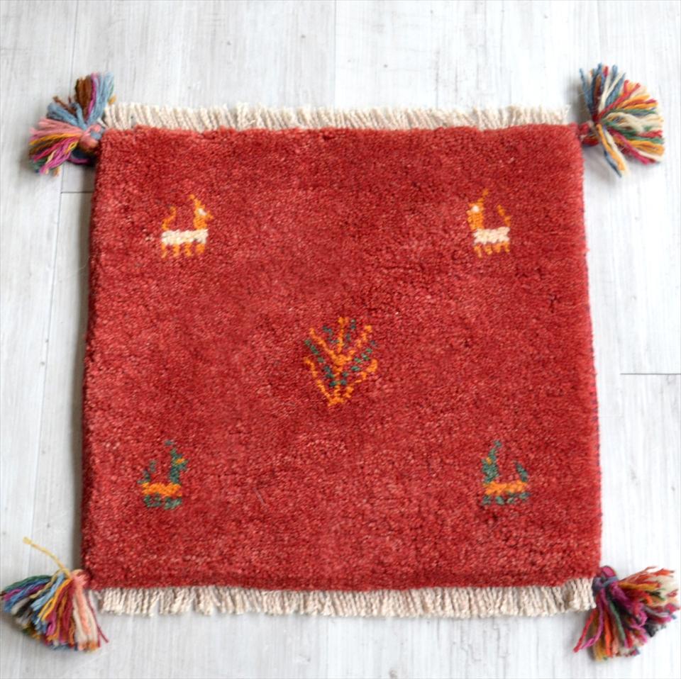 ギャッベ Gabbeh イラン南部の遊牧民・カシュカイ族の手織りラグ40x41cm 座布団サイズ レッド 動物と植物モチーフ