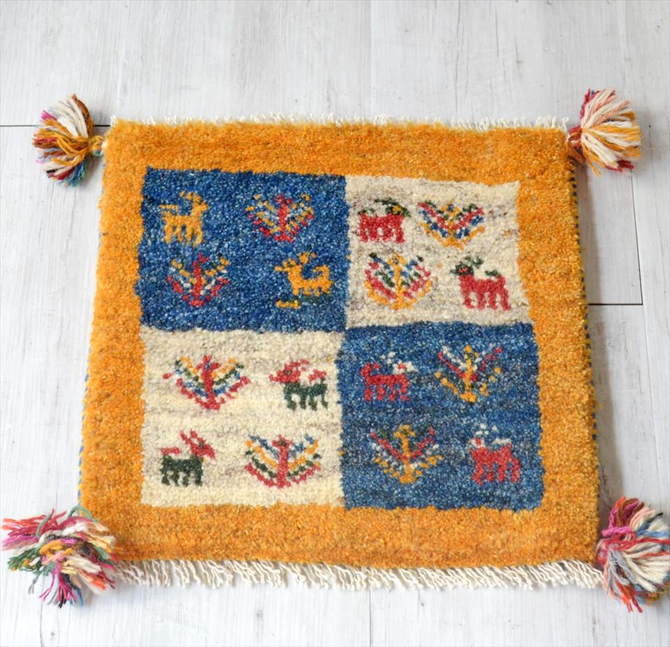 ギャッベ Gabbeh イラン南部の遊牧民・カシュカイ族の手織りラグ41x41cm 座布団サイズ イエロー カラフルタイル 動物と植物モチーフ