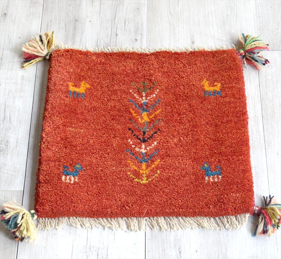 ギャッベ Gabbeh イラン南部の遊牧民・カシュカイ族の手織りラグ38x40cm 座布団サイズ レッド 動物と植物モチーフ