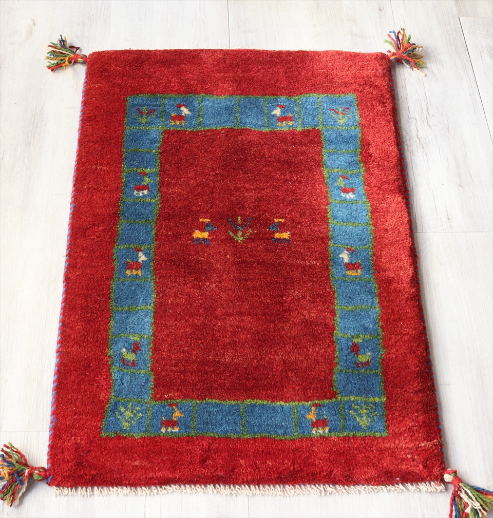 ギャベ Gabbeh イラン遊牧民族の手織りラグ 玄関マットサイズ86x55cm レッド&ブルーボーダー 枠縁デザイン 動物と植物モチーフ