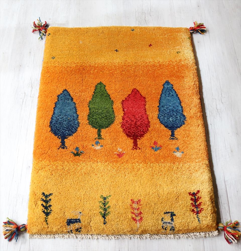 ギャッベ 手織りラグ イラン製 ウール100% 玄関マットサイズ88x58cm イエロー オレンジ カラフルな4本の樹 動物モチーフ