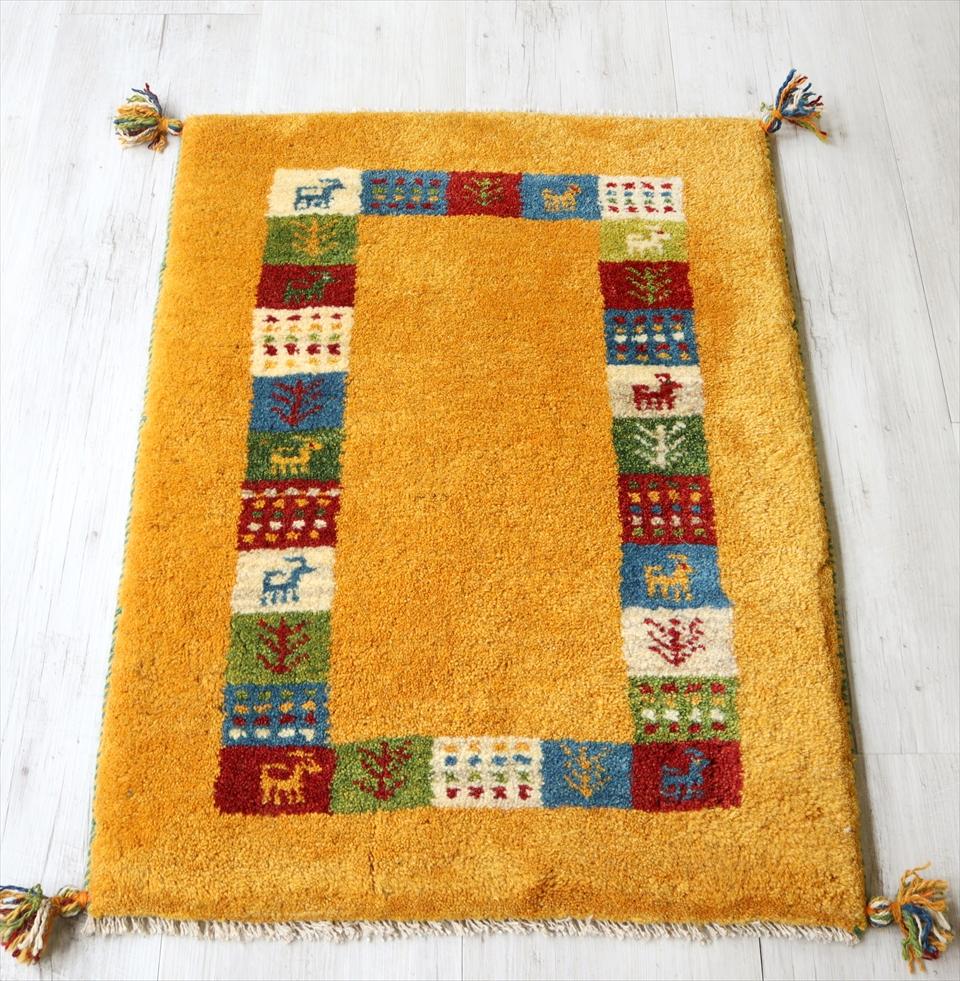 ギャッベ 手織りラグ イラン製 ウール100% 玄関マットサイズ87x60cm イエロー カラフルタイル 動物と植物モチーフ