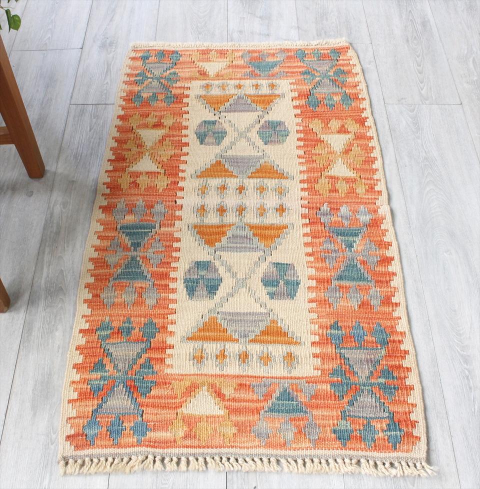 色にこだわる~ワンランク上のカイセリ産手織りキリム109×60cmオレンジ&ブルー イヤリングのモチーフ
