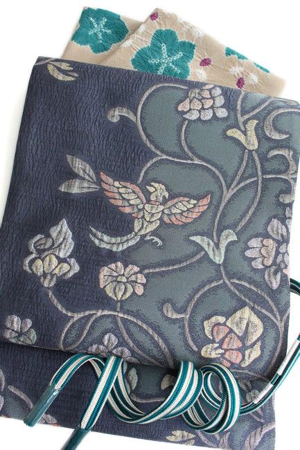 特選西陣織正絹袋帯 膨れ織り 錆青地 鳳凰更紗唐草模様 超軽量