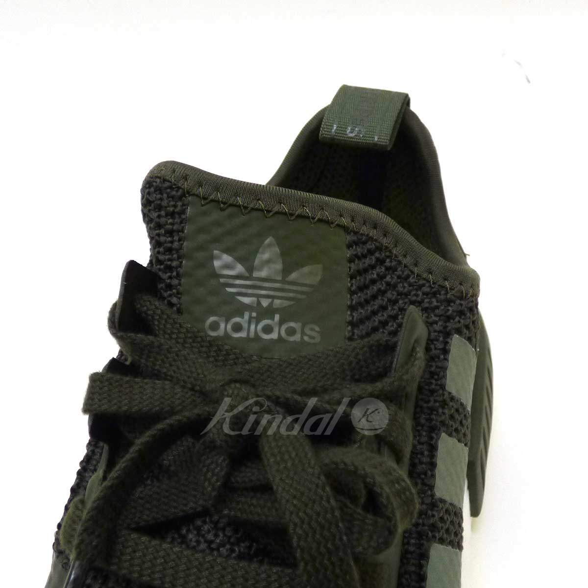 77008e35f kindal  adidas NMD R1 knight cargo sneakers
