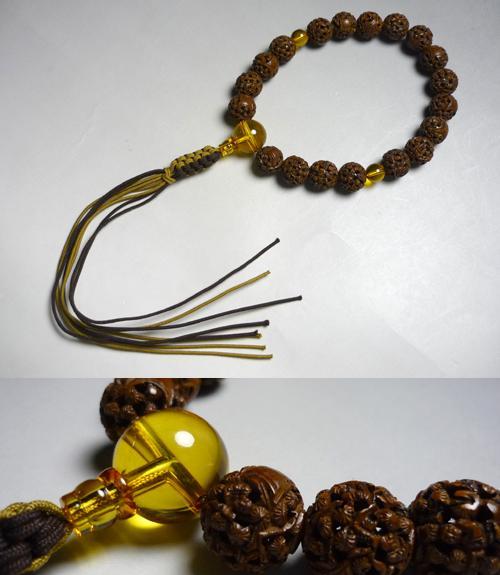 男性用のお数珠インド龍眼菩提樹羅漢彫り18玉琥珀仕立て紐房