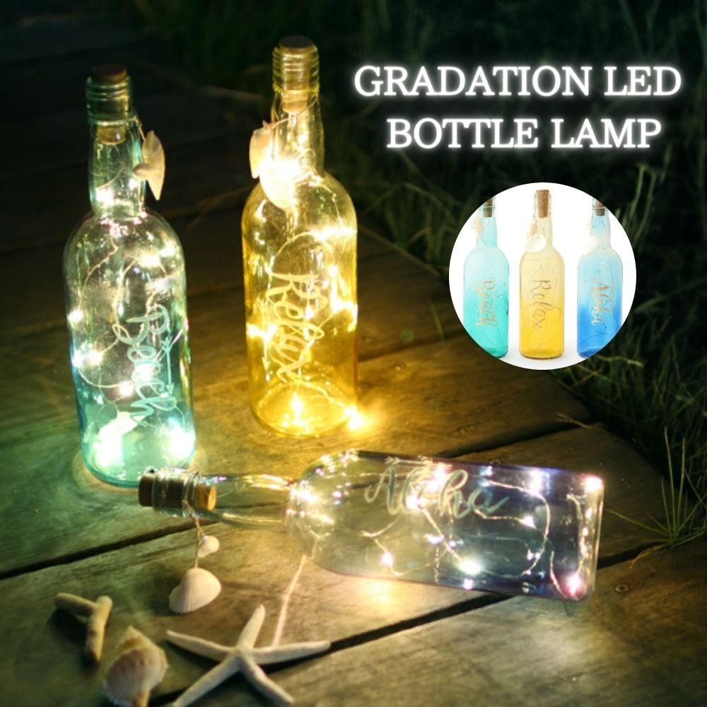 ビーチリゾートのおしゃれなバーにあるようなインテリアボトルです ご自宅でのパーティーや食卓に 電池式なので野外でもご利用頂けます LEDで長持ち 癒される光を灯します インテリアライト リゾート 日本製 インテリア 瓶 置物 ハワイアン雑貨 ランタン クリスマス雑貨 グランピング ライト ボトルランプ LEDランタン 飾り led パーティー おしゃれ グラデーション 倉 LED クリスマス