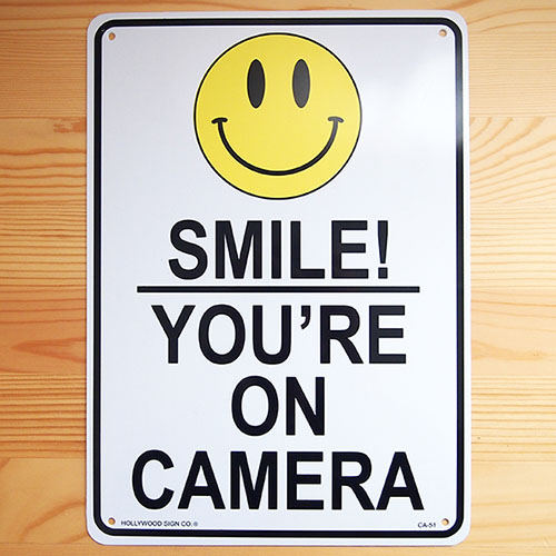 So there are signs and plastic sign board camera with a smile (shoplifting  monitored) Smile! You're on Camera CA-51 * not available