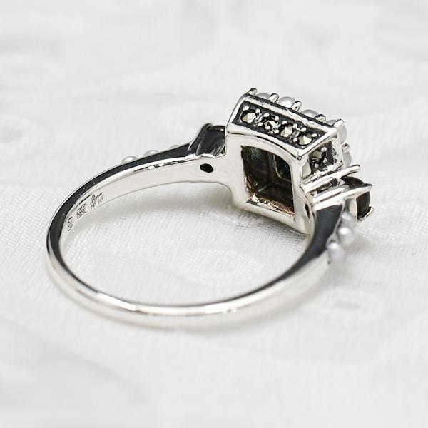 5 3//4 inch Oval Eye Hook Bangle Bracelet with a St Januarius charm.