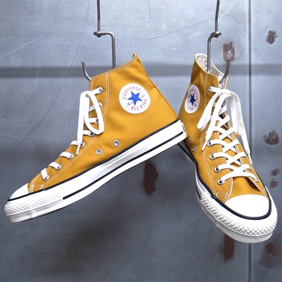 mustard yellow converse high tops