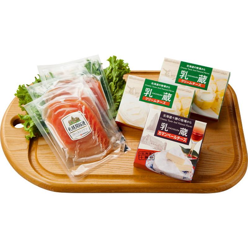 北海道産牛乳を使用したなめらかな口当たりのクリームチーズとカマンベールチーズ。ロースシンケン生ハムはしっとりとした生ハムで岩塩を使用し、まろやかな塩味に仕上げました。 生ハム&チーズセット 8572[メーカー直送品・メーカー指定熨斗]送料無料