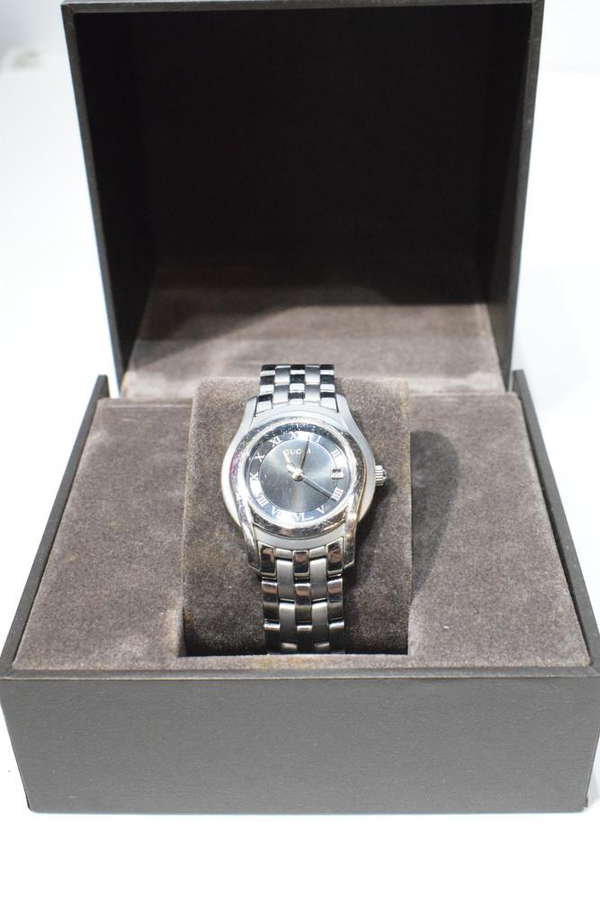 【中古】GUCCI グッチ レディース ラウンドGマーク 腕時計 シルバー 文字盤ブラック クォーツ GQ5505 YA055506