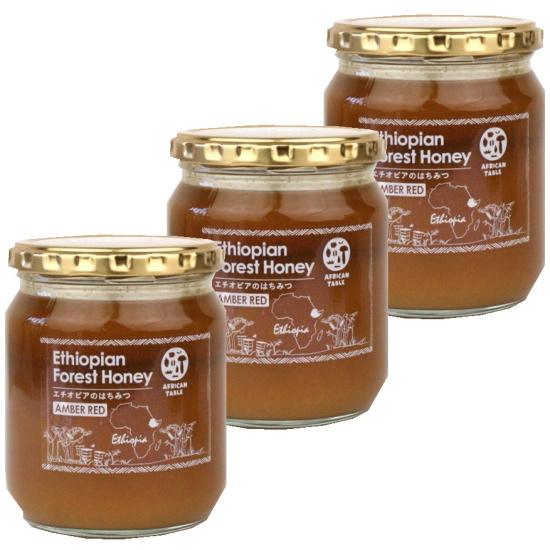 生蜂蜜 赤い実をつけるギニアフトモモから集められすっきりした甘みにスパイシーな香りが同居したコーヒーとともに後味を楽しみたい大人の蜂蜜です アンバーレッドハニー550g×3 無濾過 非加熱 最安値 野性味溢れ少し喉にヒリッとくる刺激がクセになります NEW