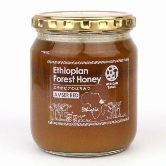 生蜂蜜 赤い実をつけるギニアフトモモから集められすっきりした甘みにスパイシーな香りが同居したコーヒーとともに後味を楽しみたい大人の蜂蜜です 野性味溢れ少し喉にヒリッとくる刺激がクセになります 最新号掲載アイテム 生はちみつ メーカー在庫限り品 非加熱 アンバーレッドハニー550g 無濾過