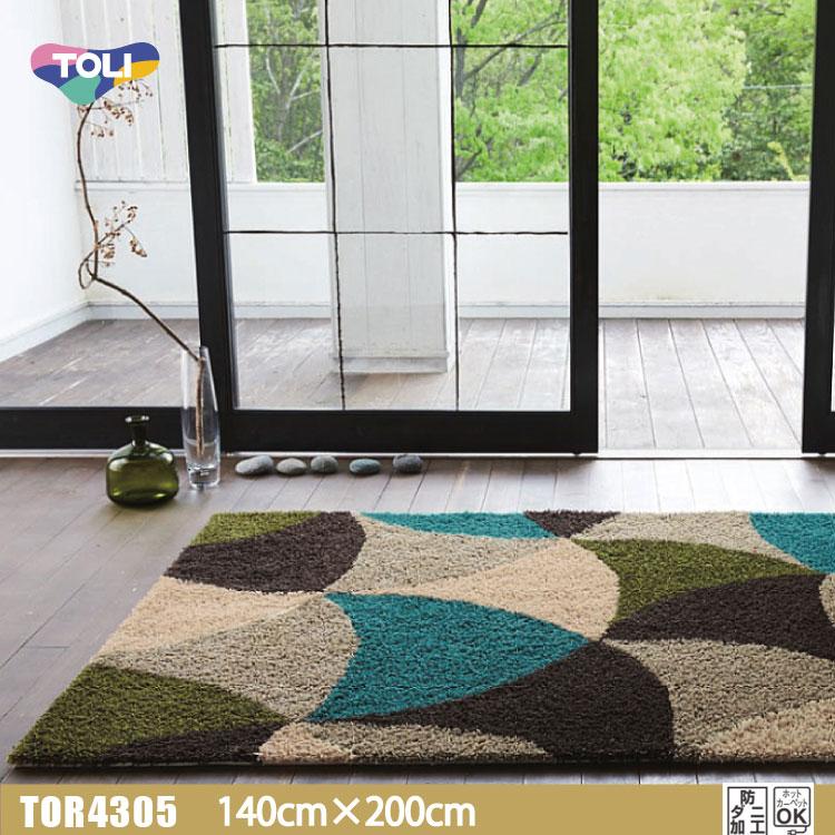 【東リ】ラグ TOR3612 140cm×200cm遊び毛がでない国産品の定番ラグ。円弧で面構成されたカラフルレトロパターン。