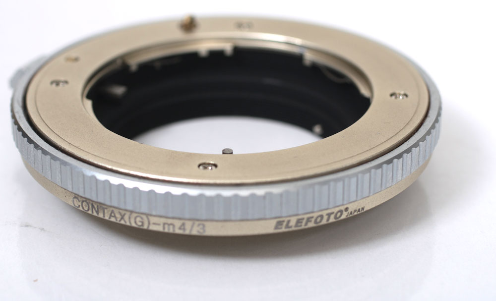 The CONTAX G-mount lenses used in the Olympus pen エレフォト Contax G lenses -  micro four thirds mount adapter 3 0 Pearl Gold finishing