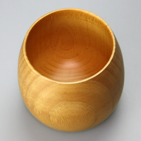A natural wooden eggcup is natural