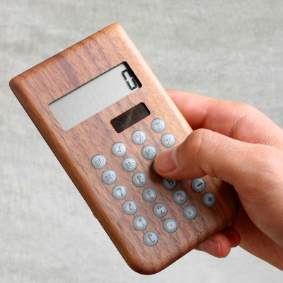 ♦ tastefully wooden solar-powered calculator, and supporter of the study / Scandinavian design