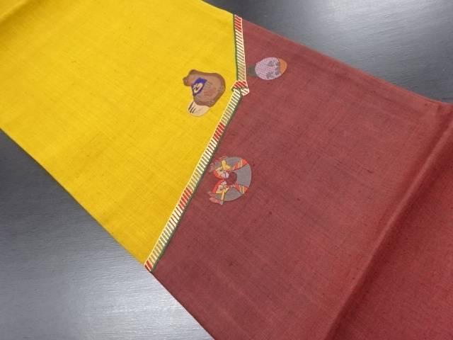 手織り真綿紬組紐に狸模様刺繍袋帯【リサイクル】【中古】