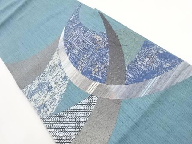 手織り紬切り嵌め本藍型染片輪車に菖蒲模様袋帯【リサイクル】【中古】