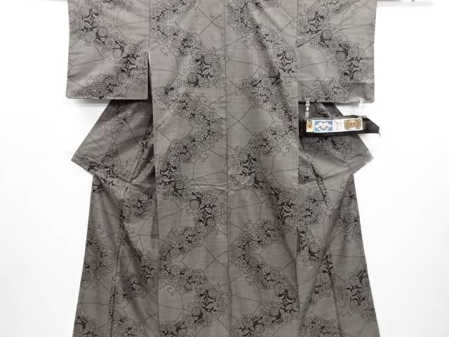 未使用品 仕立て上がり 石畳に花模様織り出し本場泥大島紬着物(9マルキ)【送料無料】