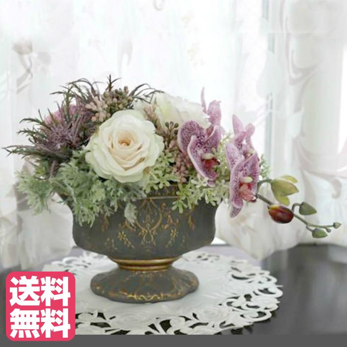 白バラと胡蝶蘭のオーバルアレンジ