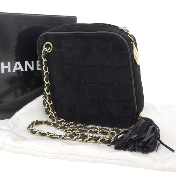 d423fe867b1255 Vintage Chanel black gold metal fittings first stand with the Chanel CHANEL  suede diamond chain shoulder bag tassel