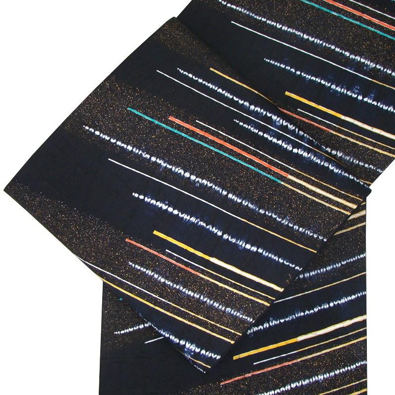 手織り牛首紬袋帯 絞り斜め縞・黒地・全通