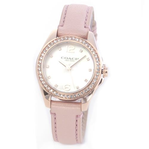 コーチ 煌びやかなラインストーンとホワイトシェルダイヤルの輝き。ラグジュアリーなレディス腕時計。 14502176【送料無料】