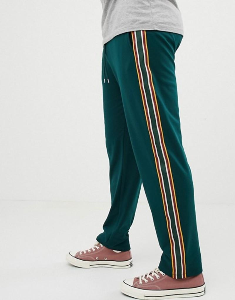 エイソス メンズ カジュアルパンツ ボトムス ASOS DESIGN retro track tapered joggers with side stripes Stain green