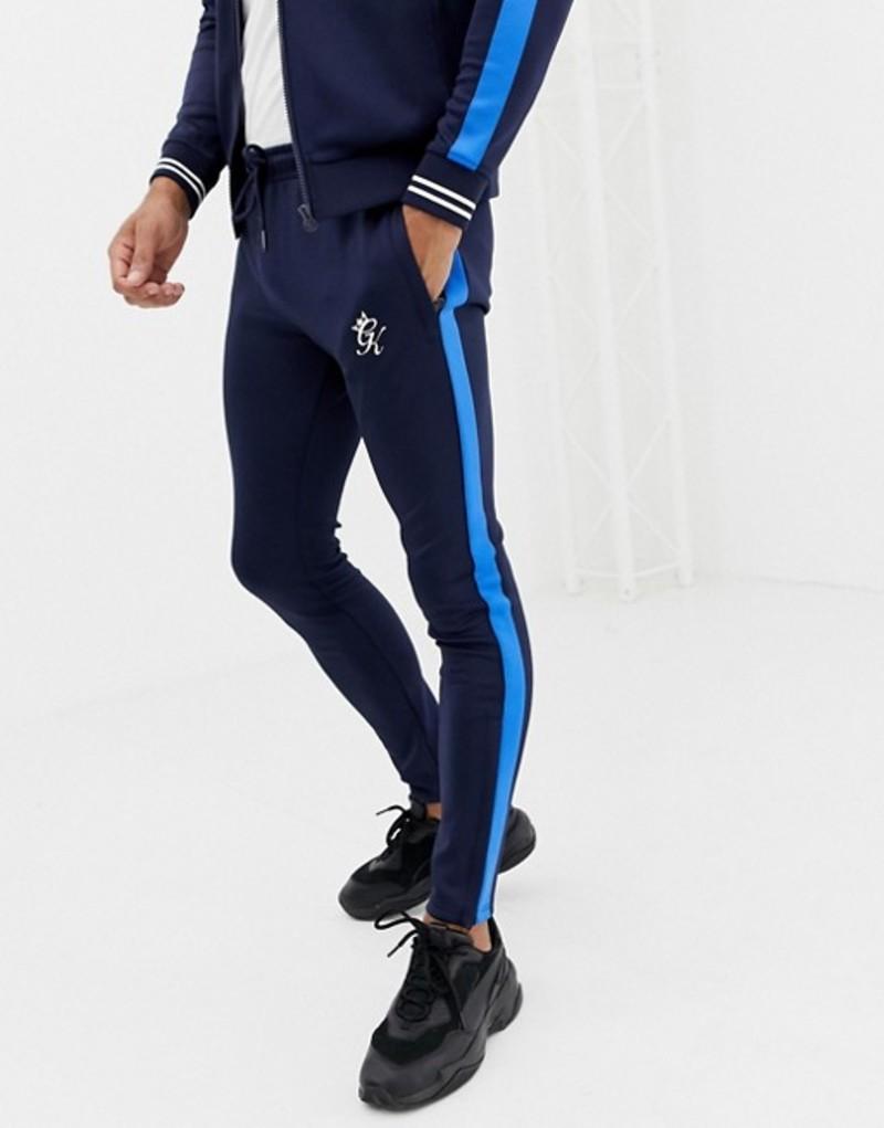 ジムキング メンズ カジュアルパンツ ボトムス Gym King skinny joggers in navy with side stripe Navy