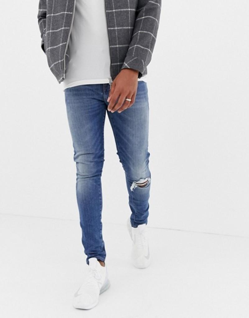 エイソス メンズ デニムパンツ ボトムス ASOS DESIGN 12.5oz super skinny jeans in mid wash blue with knee rip Mid wash blue