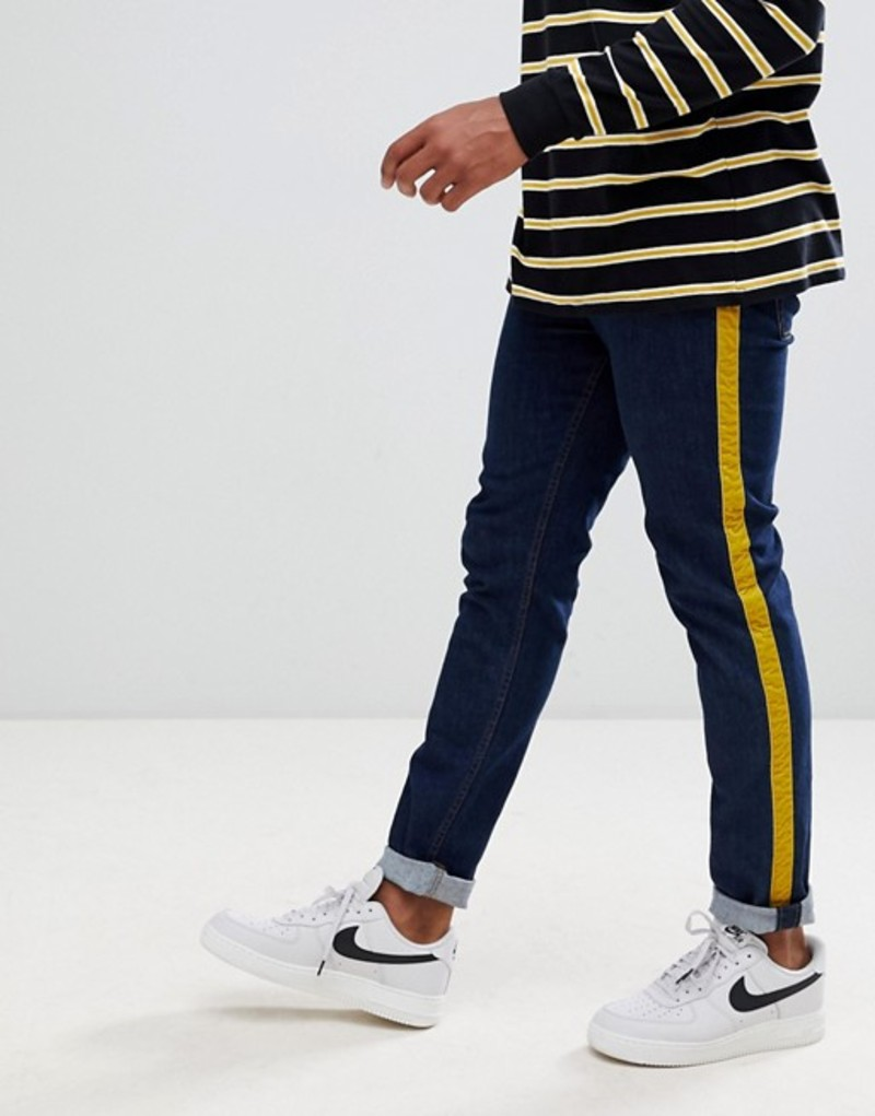 エイソス メンズ デニムパンツ ボトムス ASOS DESIGN skinny jeans in rinse wash with mustard velour side stripe Indigo