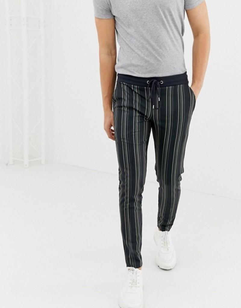 エイソス メンズ カジュアルパンツ ボトムス ASOS DESIGN skinny joggers in poly tricot fabric with all over stripes Black
